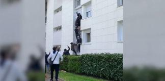 Jovens escalam prédio para salvar família de incêndio