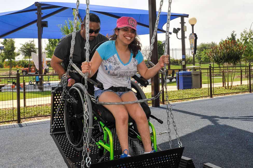 menina cadeirante roda gigante parque temático