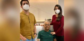 pai com filho e filha em hospital