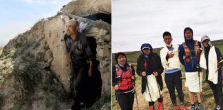 homem com resgatados em montanha