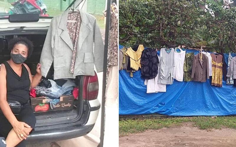 mulher mostra bazar roupas montado carro