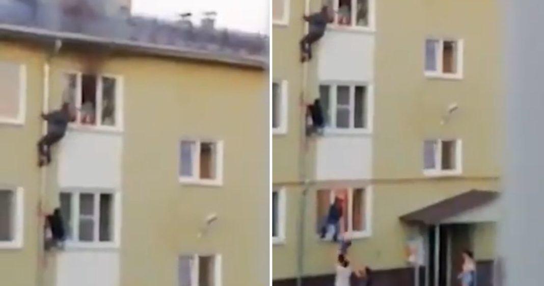 russos salvam crianças de incêndio