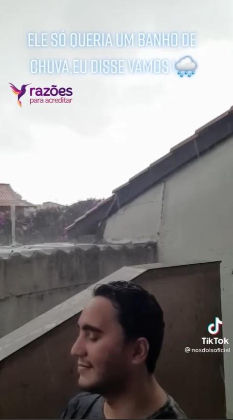casal toma banho de chuva em são paulo