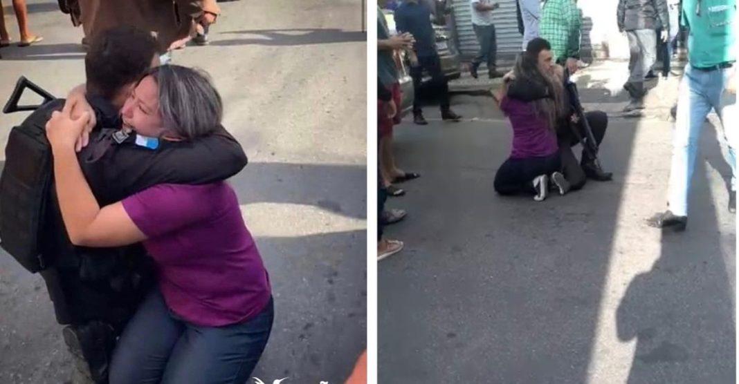policial abraça vítima após salvar sequestro