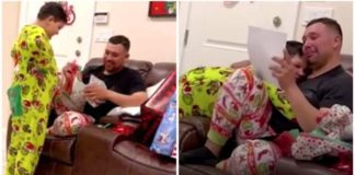 homem chora receber papéis adoção filho