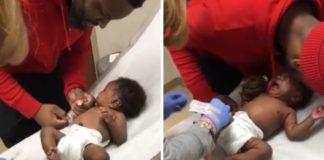 vídeo pai acalmando bebê durante vacinação
