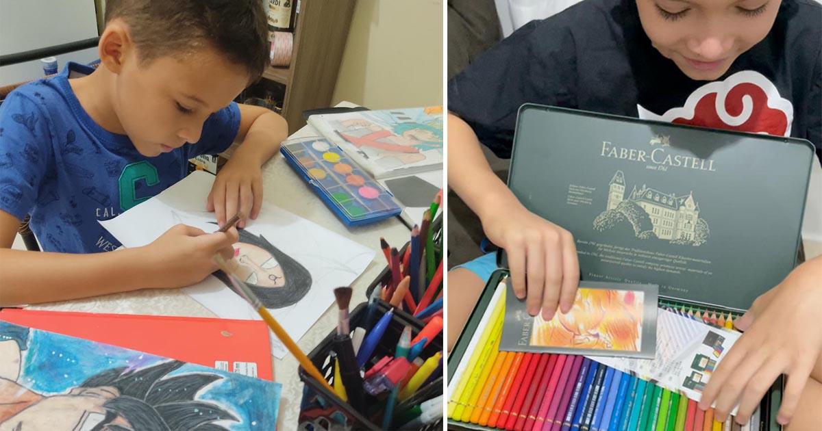 menino abre caixa de lápis de cor da faber-castell