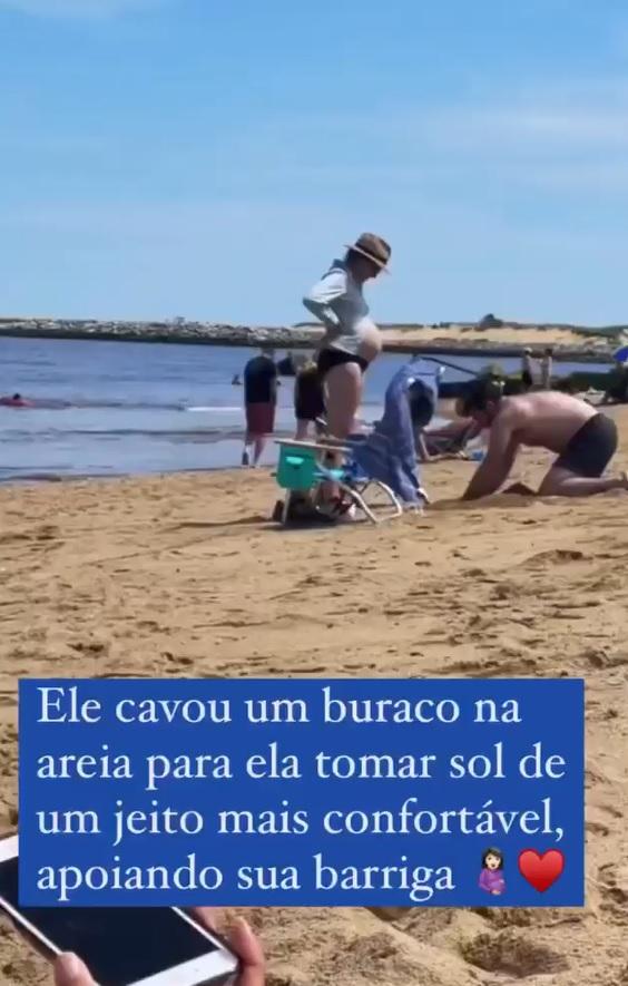 futuro papai cava buraco na areia para aconchegar barriga esposa gestante