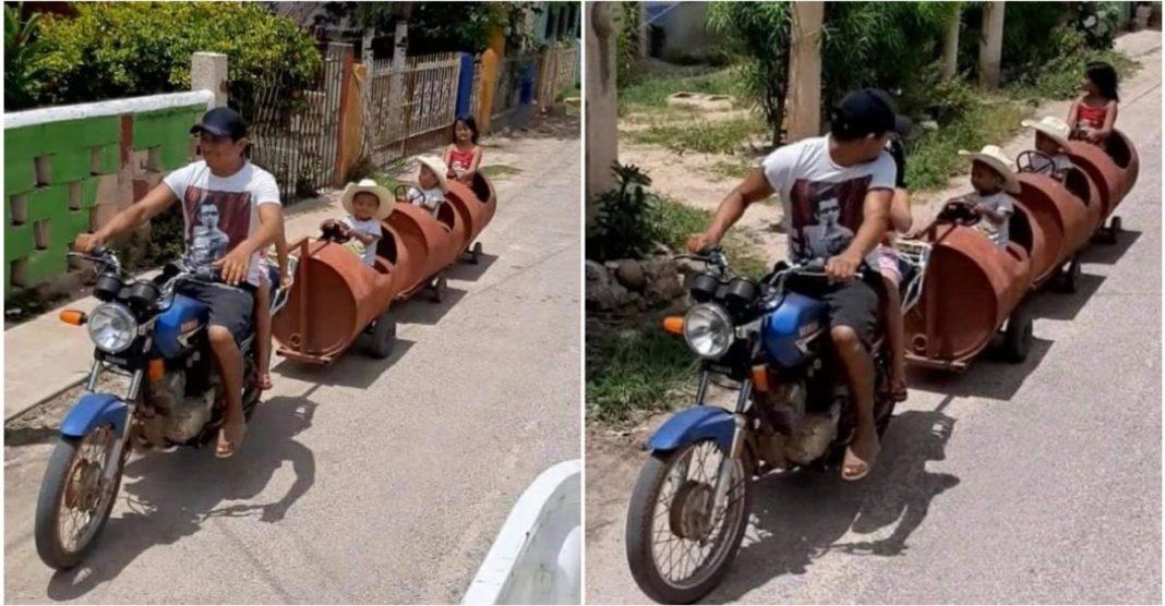 pai constrói trenzinho feito com tambores passear com os filhos